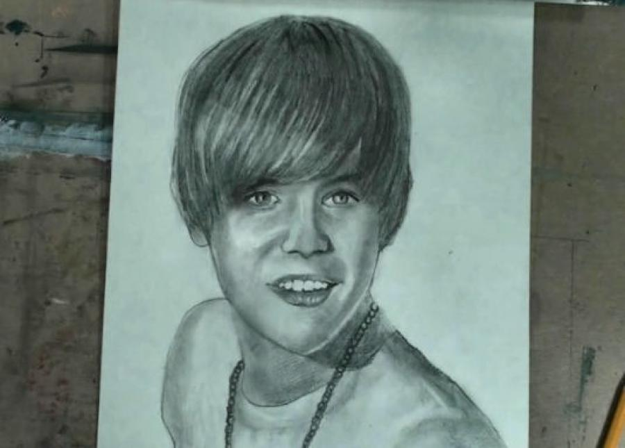 How to Draw Justin Bieber Step by Step. <p><iframe src=`https://www.youtube.com/embed/Sox1a09gUTk` width=`640` height=`390` frameborder=`0` scrolling=`auto`></iframe></p>  <p>&nbsp;</p>  <table style=`width: 730px; height: 446px;` border=`0`>  <tbody>  <tr>  <td>  <p><img title=`How to Draw Justin Bieber 1` src=`https://a5.sphotos.ak.fbcdn.net/hphotos-ak-snc6/184231_1719340196201_1619167147_31556114_4126719_n.jpg` alt=`How to Draw Justin Bieber 1` width=`720` height=`405` /></p>  <p>Step 1: Study the two main shapes before you draw. The bottom shape&nbsp;looks like a perfectly symmetrical cup but the bottom is pointed rather than flat. The top shape flooks like melting ice cream on top of a ice cream&nbsp;cone. The distances from the chin to the middle of the hairline and from the hairline to the top of Biebers head are about&nbsp;the same.</p>  <p><img title=`How to Draw Justin Bieber 2` src=`https://a3.sphotos.ak.fbcdn.net/hphotos-ak-snc6/180514_1719340356205_1619167147_31556115_6226456_n.jpg` alt=`How to Draw Justin Bieber 2` width=`720` height=`405` /></p>  <p>Step 2: Draw in the shape for Justin Bieber`s neck.</p>  <p><img title=`Draw Justin Bieber 3` src=`https://a8.sphotos.ak.fbcdn.net/hphotos-ak-snc6/180089_1719394557560_1619167147_31556166_4945979_n.jpg` alt=`Draw Justin Bieber 3` width=`720` height=`405` /></p>  <p>Step 3: Add the beads. Notice that they make a V Shape.</p>  <p><img title=`How to Draw Justin Bieber 4` src=`https://a1.sphotos.ak.fbcdn.net/hphotos-ak-snc6/183650_1719340476208_1619167147_31556116_3238534_n.jpg` alt=`How to Draw Justin Bieber 4` width=`720` height=`405` /></p>  <p>Step 4: Add his shirt line. Notice the placement of the lines in comparison to the&nbsp;edges of the paper.</p>  </td>  </tr>  </tbody>  </table>  <p>  <script type=`text/javascript`><!--  google_ad_client = `pub-6730899040960500`;  /* 728x90, created 5/25/10 */  google_ad_slot = `6501615489`;  google_ad_width = 728;  google_ad_height = 90;  // --></script>  <script src=`https://pagead2.googlesyndication.com/pagead/show_ads.js` type=`text/javascript`><!--  <table border=`0`><tbody><tr><td> </td></tr></tbody></table>  // --></script>  </p>  <p>  <script src=`https://pagead2.googlesyndication.com/pagead/show_ads.js` type=`text/javascript`></script>  </p>  <p>  <table style=`width: 732px; height: 22px;` border=`0`>  <tbody>  <tr>  <td>  <p>&nbsp;<img title=`How to Draw Justin Bieber 5` src=`https://a7.sphotos.ak.fbcdn.net/hphotos-ak-snc6/184294_1719340596211_1619167147_31556117_7729331_n.jpg` alt=`How to Draw Justin Bieber 5` width=`720` height=`405` /></p>  <p>&nbsp;</p>  <p>Step 5: Add Bieber`s eyes directly below the hairline. His eyes are football shaped and the iris of the eye forms a U shape inside the football shape. Notice that there is only one eyebrow visible. Here is a close up</p>  <p><img title=`How to Draw Justin Bieber 6` src=`https://a8.sphotos.ak.fbcdn.net/hphotos-ak-snc6/183989_1719340796216_1619167147_31556118_1474419_n.jpg` alt=`How to Draw Justin Bieber 6` width=`720` height=`405` /></p>  <p>Step 6: Add Bieber`s Nose. Notice the extra shape on the side.</p>  <p><img title=`How to Draw Justin Bieber Step by Step` src=`https://a2.sphotos.ak.fbcdn.net/hphotos-ak-ash1/180822_1719340956220_1619167147_31556119_619040_n.jpg` alt=`How to draw Justin Bieber Step by Step` width=`720` height=`405` /></p>  <p>Step 7: Add the shape for his top lip. The shape is like a flattened letter M and the corners of the mouth shape align with the pupils in the eye shape.</p>  <p><img title=`how to draw Justin Bieber Step by Step 8` src=`https://a7.sphotos.ak.fbcdn.net/hphotos-ak-snc6/184622_1719341116224_1619167147_31556120_2254123_n.jpg` alt=`how to draw Justin Bieber Step by Step 8` width=`720` height=`405` /></p>  <p>&nbsp;Step 8: Add the bottom lip. It is shaped like a banana.</p>  <p><img title=`How to Draw Justin Bieber 8` src=`https://a3.sphotos.ak.fbcdn.net/hphotos-ak-snc6/182955_1719341236227_1619167147_31556122_7443080_n.jpg` alt=`How to Draw Justin Bieber 8` width=`720` height=`405` /></p>  <p>Step 9: Add the teeth. Take some extra time to observe this step. Notice that I did not put in lines to separate the teeth yet, only points at the bottom and top.</p>  <p><img title=`draw justin bieber` src=`https://a5.sphotos.ak.fbcdn.net/hphotos-ak-ash1/182609_1719341396231_1619167147_31556123_6589983_n.jpg` alt=`draw justin bieber` width=`720` height=`405` /></p>  <p>Step 10: Add the highlight shapes in the hair. This step is optional and do not stress if you do not perfectly draw this difficult shape.</p>  </td>  </tr>  </tbody>  </table>  &nbsp;</p>  <p>&nbsp;<span style=`font-size: large;`>Supplies I Used to Draw Justin Bieber</span></p>  <form action=`https://www.jdoqocy.com/interactive` enctype=`application/x-www-form-urlencoded` method=`get`>  <table style=`width: 600px;` border=`0` cellspacing=`0` cellpadding=`5`>  <tbody>  <tr>  <td width=`10%` valign=`top`>`&gt;<img src=`https://www.dick-blick.com/items/222/06/22206-0159-2ww-m.jpg` border=`0` alt=`15-Piece Drawing Set` /></td>  <td valign=`top`>  <p><strong><span style=`font-size: medium;`>15-Piece Drawing Set</span></strong></p>  <p><span style=`font-size: x-small;`><strong>Merrill`s Opinion:</strong> Faber-Castell makes the&nbsp;best drawing pencils. These pencils&nbsp;are mixed with graphite and clay and&nbsp;enhance an artists ability to create and layer dark tones.&nbsp;You will see me use this set in almost all of my videos.&nbsp; </span></p>  <hr />  <input name=`pid` type=`hidden` value=`3724826` /> <input name=`aid` type=`hidden` value=`10495307` /> <input name=`cjsku` type=`hidden` value=`22206-0159` /> <input name=`url` type=`hidden` value=`https://www.dickblick.com/products/faber-castell-9000-pencils/?wmcp=cj&amp;wmcid=feeds&amp;wmckw=22206-0159-8888` /> <input type=`submit` value=`Buy` /></td>  </tr>  </tbody>  </table>  </form>  <p><img src=`https://www.awltovhc.com/image-3724826-10495307` border=`0` alt=`` width=`1` height=`1` /></p>  <form action=`https://www.anrdoezrs.net/interactive` enctype=`application/x-www-form-urlencoded` method=`get`>  <table style=`width: 600px;` border=`0` cellspacing=`0` cellpadding=`5`>  <tbody>  <tr>  <td width=`10%` valign=`top`><img src=`https://www.dick-blick.com/items/204/43/20443-2061-1-2ww-m.jpg` border=`0` alt=`Lyra Graphite Crayons` /></td>  <td valign=`top`>  <p><strong><span style=`font-size: medium;`>Lyra Graphite Crayons</span></strong></p>  <p><span style=`font-size: x-small;`><strong>Merrill`s Opinion:</strong> Do you ever get TIRED of shading with a fine `tip` pencil? Get my `point`? This tool will save you time and money.</span></p>  <p><span style=`font-size: x-small;`>Click `MORE` to see me use this product in a video-</span></p>  <hr />  <input name=`pid` type=`hidden` value=`3724826` /> <input name=`aid` type=`hidden` value=`10495307` /> <input name=`cjsku` type=`hidden` value=`20443-2091` /> <input name=`sid` type=`hidden` value=`2858963` /> <input name=`url` type=`hidden` value=`https://www.dickblick.com/products/lyra-graphite-crayons/?wmcp=cj&amp;wmcid=feeds&amp;wmckw=20443-2091` /> <input type=`submit` value=`Buy` /></td>  </tr>  </tbody>  </table>  </form>  <p><img src=`https://www.ftjcfx.com/image-3724826-10495307` border=`0` alt=`` width=`1` height=`1` /></p>  <form action=`https://www.tkqlhce.com/interactive` enctype=`application/x-www-form-urlencoded` method=`get`>  <table style=`width: 600px;` border=`0` cellspacing=`0` cellpadding=`5`>  <tbody>  <tr>  <td width=`10%` valign=`top`><img src=`https://www.dick-blick.com/items/050/80/05080-9002-2-2ww-m.jpg` border=`0` alt=`Robert Simmons White Sable Brushes` /></td>  <td valign=`top`>  <p><strong><span style=`font-size: medium;`>Robert Simmons White Sable Brushes</span></strong></p>  <p><span style=`font-size: x-small;`><strong>Merrill`s Opinion</strong>: Robert Simmons brushes get better with age. These synthetic brushes collect particles of graphite as they are rubbed on a piece of paper. This enables me to&nbsp;softly move and blend tones. Most often I use the `Flat Size 10` brush but it helps to have a variety of sizes and shapes.&nbsp;</span></p>  <hr />  <input name=`pid` type=`hidden` value=`3724826` /> <input name=`aid` type=`hidden` value=`10495307` /> <input name=`cjsku` type=`hidden` value=`05824-1010` /> <input name=`sid` type=`hidden` value=`2858963` /> <input name=`url` type=`hidden` value=`https://www.dickblick.com/products/robert-simmons-white-sable-brushes/?wmcp=cj&amp;wmcid=feeds&amp;wmckw=05824-1010` /> <input type=`submit` value=`Buy` />  <p>&nbsp;</p>  </td>  </tr>  </tbody>  </table>  </form>  <p><img src=`https://www.awltovhc.com/image-3724826-10495307` border=`0` alt=`` width=`1` height=`1` /></p>  <form action=`https://www.kqzyfj.com/interactive` enctype=`application/x-www-form-urlencoded` method=`get`>  <table style=`width: 600px;` border=`0` cellspacing=`0` cellpadding=`5`>  <tbody>  <tr>  <td width=`10%` valign=`top`><img src=`https://www.dick-blick.com/items/228/66/22866-1059-2ww-m.jpg` border=`0` alt=`Loew-Cornell Blending Stumps` /></td>  <td valign=`top`>  <p><strong><span style=`font-size: medium;`>Loew-Cornell Blending Stumps</span></strong></p>  <p><span style=`font-size: x-small;`><strong>Merrill`s Opinion</strong>- INVALUBLE tools for blending! These will cost you LESS than a trip on&nbsp;the subway (Less than 2 dollars) and enhance your shading capacity substantially! I like Leow-Cornell because the&nbsp;stump is more compact and&nbsp;the tips do not wear as easily as other brands.&nbsp;I use these tools in almost every one of my videos.</span></p>  <hr />  <input name=`pid` type=`hidden` value=`3724826` /> <input name=`aid` type=`hidden` value=`10495307` /> <input name=`cjsku` type=`hidden` value=`22866-4014` /> <input name=`sid` type=`hidden` value=`2858963` /> <input name=`url` type=`hidden` value=`https://www.dickblick.com/products/loew-cornell-blending-stumps/?wmcp=cj&amp;wmcid=feeds&amp;wmckw=22866-4014` /> <input type=`submit` value=`Buy` /></td>  </tr>  </tbody>  </table>  </form>  <p><img src=`https://www.awltovhc.com/image-3724826-10495307` border=`0` alt=`` width=`1` height=`1` /></p>  <form action=`https://www.tkqlhce.com/interactive` enctype=`application/x-www-form-urlencoded` method=`get`>  <table style=`width: 600px;` border=`0` cellspacing=`0` cellpadding=`5`>  <tbody>  <tr>  <td width=`10%` valign=`top`><img src=`https://www.dick-blick.com/items/102/09/10209-OC3-m.jpg` border=`0` alt=`Blick White Sulphite Drawing Paper` /></td>  <td valign=`top`>  <p><strong><span style=`font-size: medium;`>Blick White Sulphite Drawing Paper</span></strong></p>  <p><span style=`font-size: x-small;`><strong>Merrill`s Opinion</strong>: Really, I DARE YOU, try to find a better value than this one! 500 sheets of 80LB (thick) drawing paper for $11.50. AMAZING DEAL!......If you use computer paper to create your drawings, you are ROBBING yourself from seeing what you can really do! This paper has more `tooth` (texture on the surface) than computer paper and your ability to shade will be enhanced. </span></p>  <hr />  <input name=`pid` type=`hidden` value=`3724826` /> <input name=`aid` type=`hidden` value=`10495307` /> <input name=`cjsku` type=`hidden` value=`10209-1033` /> <input name=`sid` type=`hidden` value=`2858963` /> <input name=`url` type=`hidden` value=`https://www.dickblick.com/products/blick-white-sulphite-drawing-paper/?wmcp=cj&amp;wmcid=feeds&amp;wmckw=10209-1033` /> <input type=`submit` value=`Buy` /></td>  </tr>  </tbody>  </table>  <p>&nbsp;</p>  <p style=`TEXT-ALIGN: center`>&nbsp;</p>  </form>  <p><img src=`https://www.ftjcfx.com/image-3724826-10495307` border=`0` alt=`` width=`1` height=`1` />   <table border=`0`>  <tbody>  <tr>  <td>  <p>&nbsp;</p>  <p style=`TEXT-ALIGN: center`><span style=`font-size: medium;`>Shading</span></p>  <p><img title=`bieber hair drawing` src=`https://a8.sphotos.ak.fbcdn.net/hphotos-ak-snc6/183197_1719341596236_1619167147_31556124_6028059_n.jpg` alt=`bieber shading` width=`720` height=`405` /></p>  <p><img title=`bieber pencil drawing` src=`https://a2.sphotos.ak.fbcdn.net/hphotos-ak-snc6/184842_1719341956245_1619167147_31556125_1010815_n.jpg` alt=`bieber` width=`720` height=`405` /></p>  <p><img title=`justin bieber` src=`https://a4.sphotos.ak.fbcdn.net/hphotos-ak-ash1/182274_1719342076248_1619167147_31556126_4289339_n.jpg` alt=`bieber` width=`720` height=`405` /></p>  <p><img title=`h` src=`https://a6.sphotos.ak.fbcdn.net/hphotos-ak-ash4/185666_1719342236252_1619167147_31556127_2410003_n.jpg` alt=`h` width=`720` height=`405` /></p>  <p><img title=`jb` src=`https://a5.sphotos.ak.fbcdn.net/hphotos-ak-snc6/185902_1719342476258_1619167147_31556128_764319_n.jpg` alt=`jb` width=`720` height=`405` /></p>  <p><img title=`youtube justin bieber` src=`https://a3.sphotos.ak.fbcdn.net/hphotos-ak-ash4/183671_1719342636262_1619167147_31556129_2368475_n.jpg` alt=`youtube justin bieber` width=`720` height=`405` /></p>  <p><img title=`jb usher` src=`https://a8.sphotos.ak.fbcdn.net/hphotos-ak-ash1/181508_1719342716264_1619167147_31556130_2464568_n.jpg` alt=`jb usher` width=`720` height=`405` /></p>  <p><img title=`justin bieber white shirt` src=`https://a4.sphotos.ak.fbcdn.net/hphotos-ak-snc6/183610_1719342956270_1619167147_31556132_3285990_n.jpg` alt=`justin bieber white shirt` width=`720` height=`405` /></p>  <p><img title=`justin bieber pencil drawing` src=`https://a1.sphotos.ak.fbcdn.net/hphotos-ak-snc6/183425_1719343436282_1619167147_31556135_1424218_n.jpg` alt=`justin bieber drawing finished` width=`720` height=`405` /></p>  </td>  </tr>  </tbody>  </table>  </p>