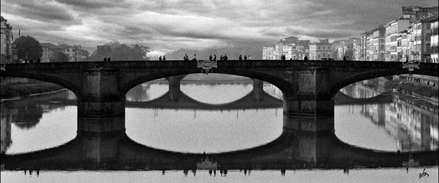 View from the Ponte Vecchio. Black-white Photography,existential-view,fine-art,-image-new-school-vclassic approach to the subject using Kodak 400 speed film.Priced unmated and unframed scanned, hand colored digitally limited edition of 10 per size price unmated unframed. All images are Limited editions on and are Giclee Print. A certificate is supplied with each sold giclee print, that provides information about Copyright ownership, print title, size, media, number in the limited edition, edition size, release date, printer name, etc. The certificate gives you a guaranty of museum quality standards and fine art value.<br /><br />Image has only 4 prints available in this size