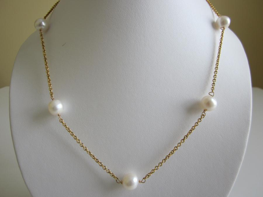 10mm White Freshwater Cultured Pearl Station Necklace. White freshwater cultured pearl station necklace, gold-filled rolo chain with nine 10mm white round cultured pearls, 28 inches length with spring ring clasp closure.<br /><br />Matching earrings available.