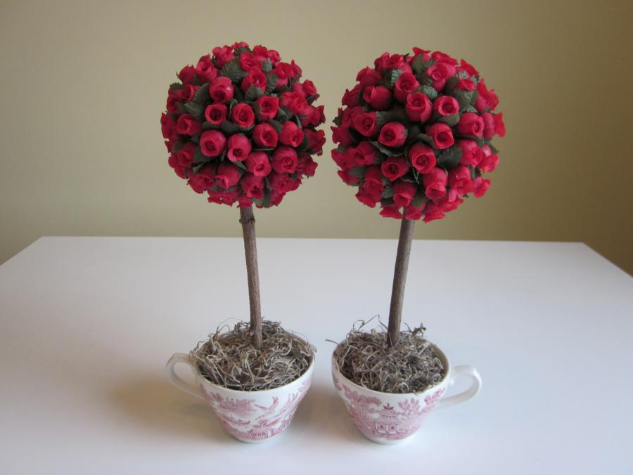 Mini Rosebud Topiary, pair. Mini red faux rosebud topiaries set in red transferware willow china teacups with Spanish moss; teacup is 2-3/4 inches high; 12` H x 4-1/2` W, overall dimensions.