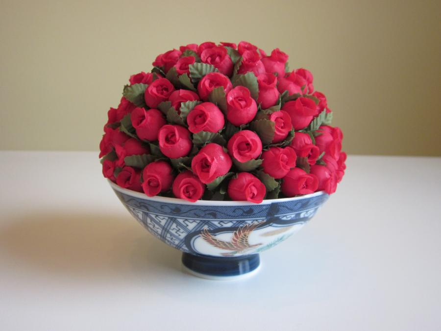 Mini Rosebud Half Moon Topiary in Bowl. Mini faux red rosebud half moon topiary set in Japanese blue-and-white rice bowl with hand-painted birds; bowl is 2-1/2` H; 5-1/2` H x 5` W overall dimensions.