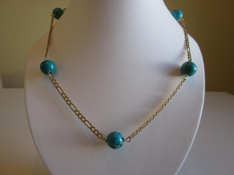 Turquoise Station Necklace. 16mm round turquoise beaded station necklace on vintage 24K gold-plated figaro chain, 26-inches length with gold-filled lobster clasp closure.<br /><br />SOLD