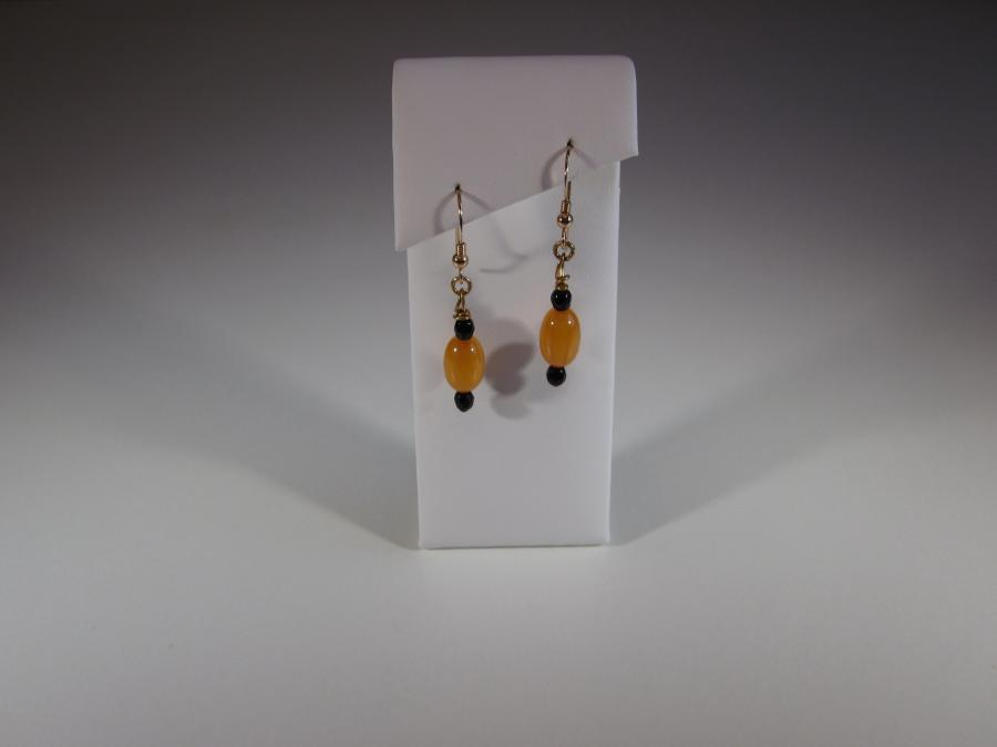 Natural Yellow Amber & Black Onyx Bead Earrings. Natural yellow amber & black onyx bead earrings, gold filled shepherd`s hook earwires for pierced earrings