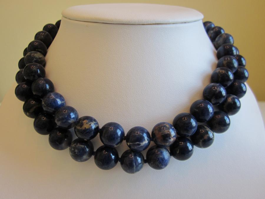 Two-Strand Blue Sodalite Necklace. 12mm round blue sodalite beaded necklace hand-knotted on dark blue silk cord, 16 inch & 16-1/2 inch length, gold-filled magnetic slide clasp.