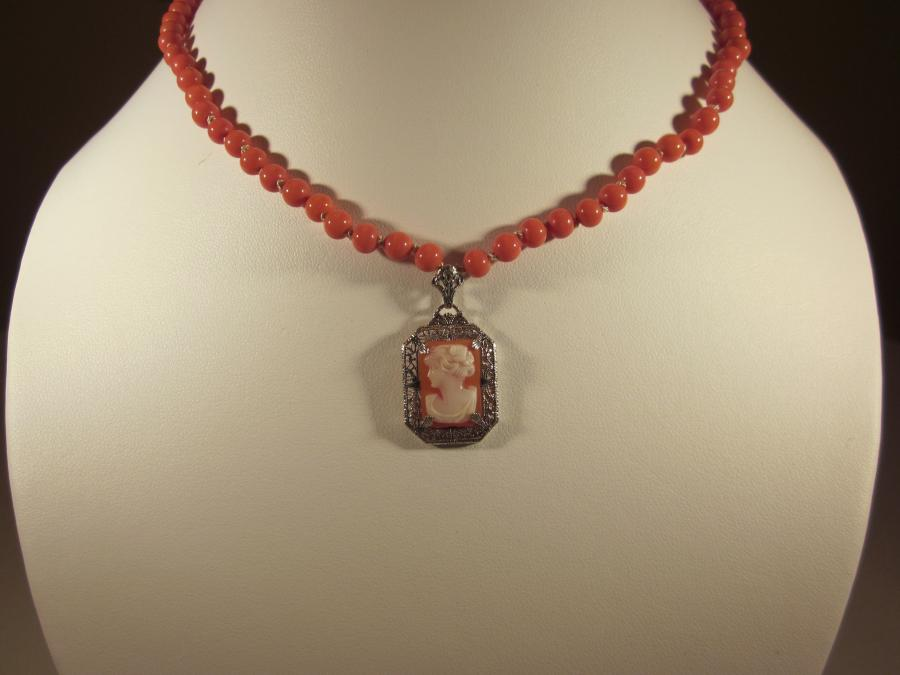 Victorian Cameo Pendant & Orange Coral Bead Necklace. Octagonal Victorian cameo pendant set in sterling silver filagree frame and orange coral bead necklace, handknotted on silk cord, sterling silver filagree clasp, 19 inches length