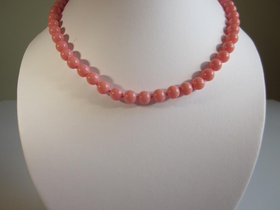 Pink Coral Bead Necklace. 7.5mm pink coral beaded necklace, hand-knotted on matching pink silk cord with a yellow gold-filled filigree oval pearl clasp, 17` length.<br /><br />Matching earrings also available.