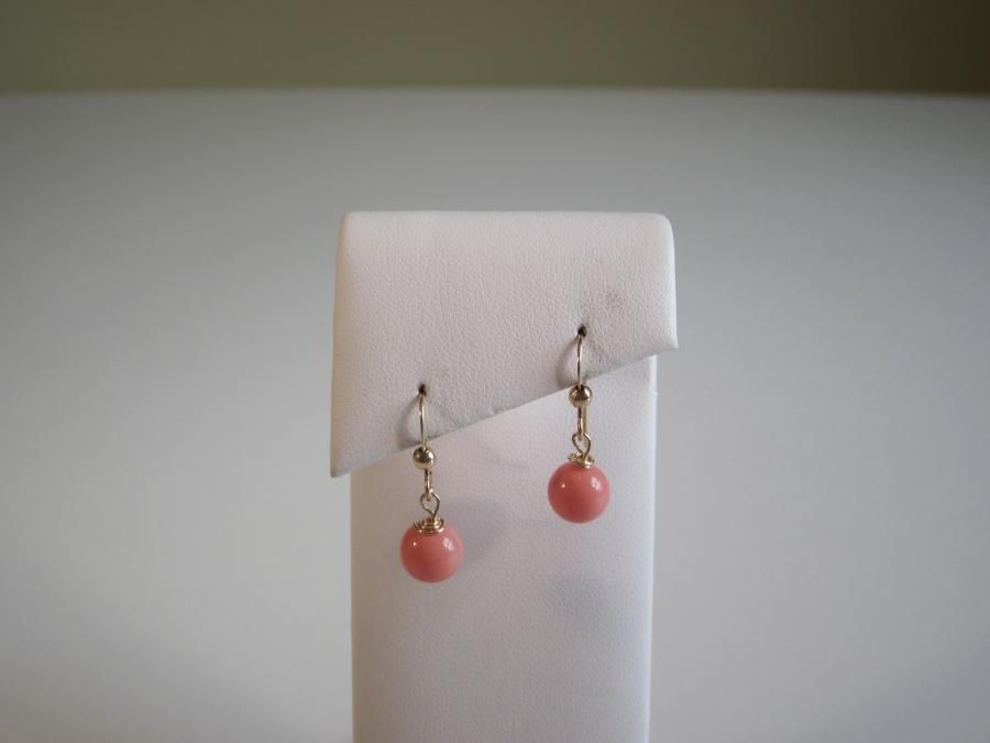Pink Coral Beaded Earrings. 7.5mm pink coral beaded earrings with yellow gold-filled shepherd`s hook earwires for pierced ears.<br /><br />Matching necklace also available.
