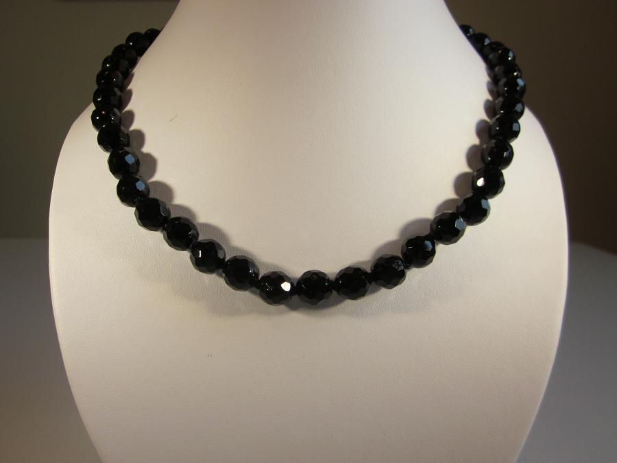 Antique Victorian Black Glass Bead Necklace. Faceted Victorian black glass beaded necklace, hand-knotted on matching black silk cord with antiqued silver filigree clasp, 19` length.<br /><br />SOLD