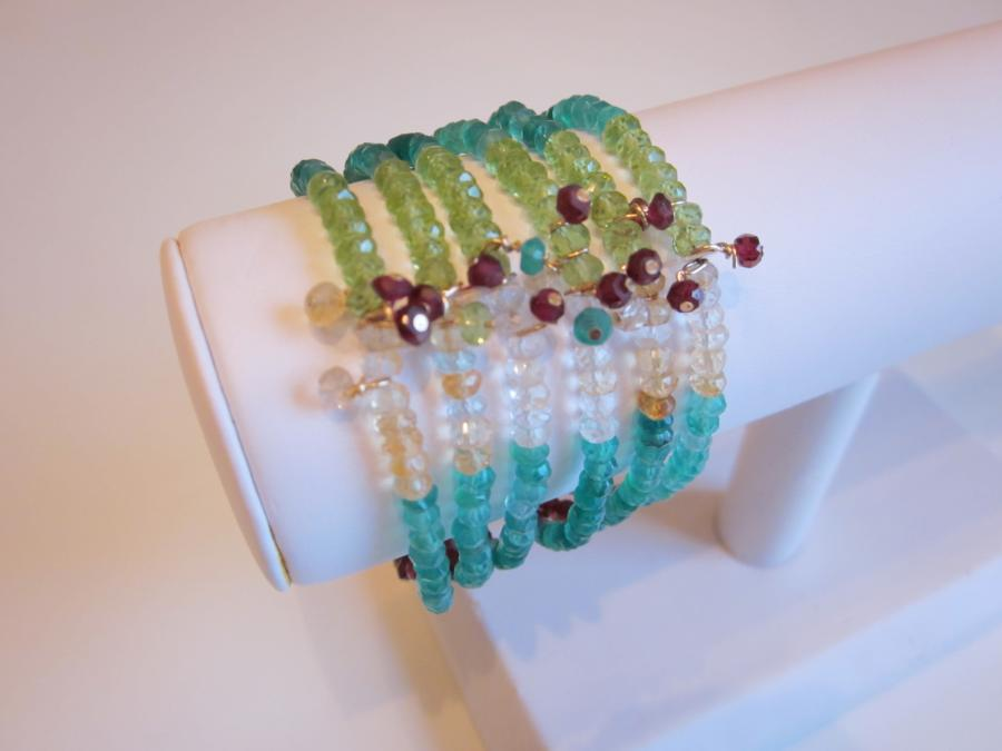 Six-Strand Multigemstone Bracelet. Six-strand multigemstone bracelet with red garnet, green quartz, citrine, peridot and clear quartz beads and magnetic gold-filled slide clasp closure.