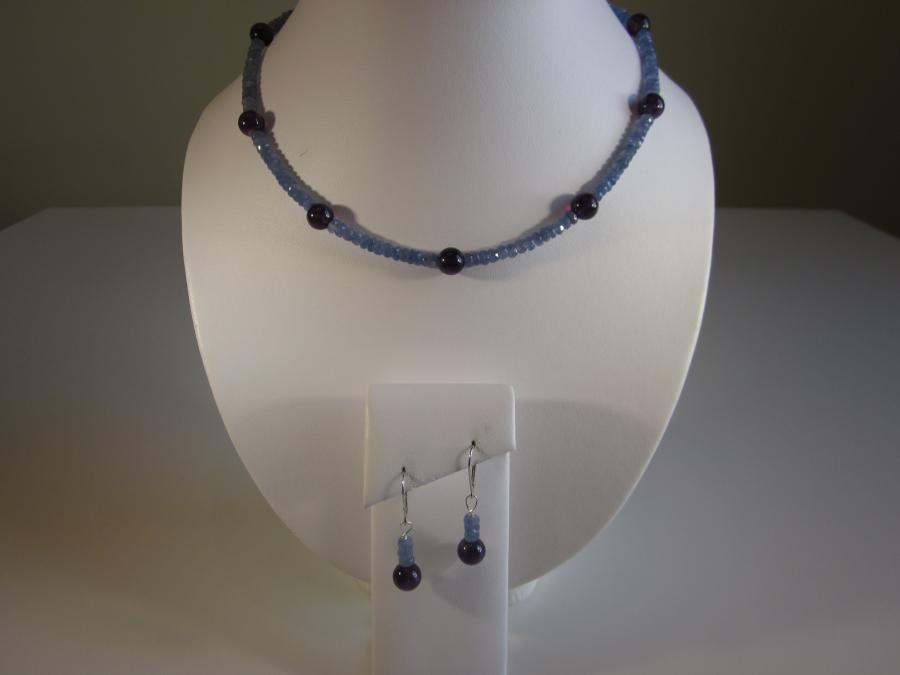 Blue Sapphire & Amethyst Demi Parure. 4mm natural blue sapphire and 8mm round amethyst beaded station necklace, 16-inches length, 14K white gold lobster clasp closure. Matching earrings, 14K white gold leverback earwires for pierced ears.