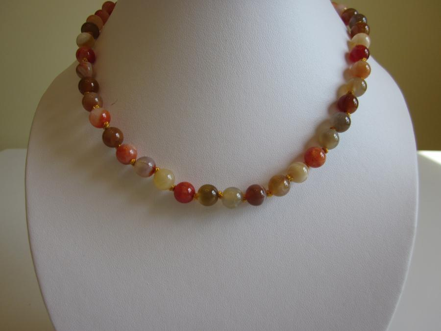 Multi-Colored Agate Necklace. 7mm round multi-colored agate beaded necklace, hand-knotted on gold silk cord, gold-filled ball safety clasp, 17-inches length.