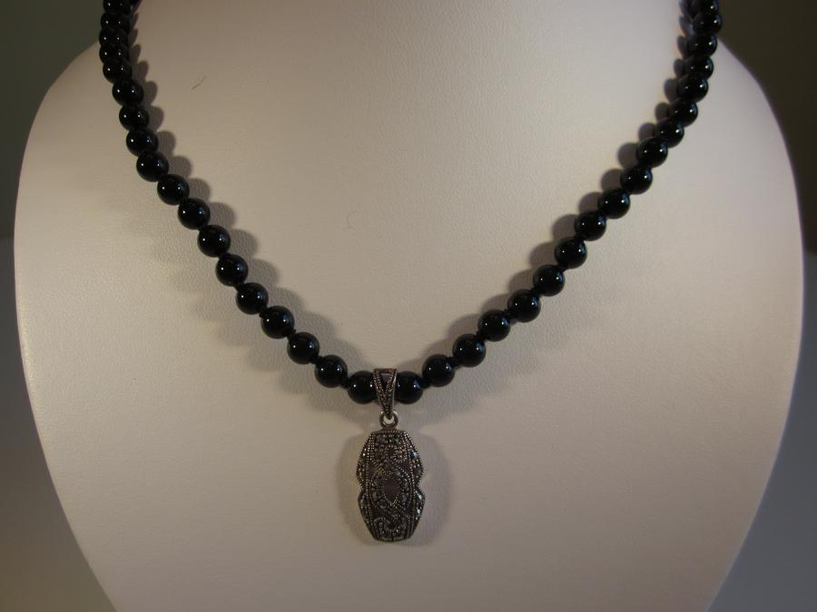 Black Onyx Beaded Necklace with Vintage Sterling Marcasite Pendant. 6.3mm round black onyx beaded necklace with vintage sterling and marcasite pendant, hand-knotted on black silk cord, finished with sterling silver lobster clasp, 18-1/2 inches length.