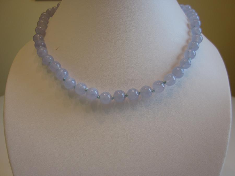 Blue Lace Agate Necklace. 8mm round blue lace agate beaded necklace, hand-knotted on light blue silk cord, finished with a sterling silver lobster clasp, 17` length.<br /><br />Matching earrings also available.<br /><br />SOLD