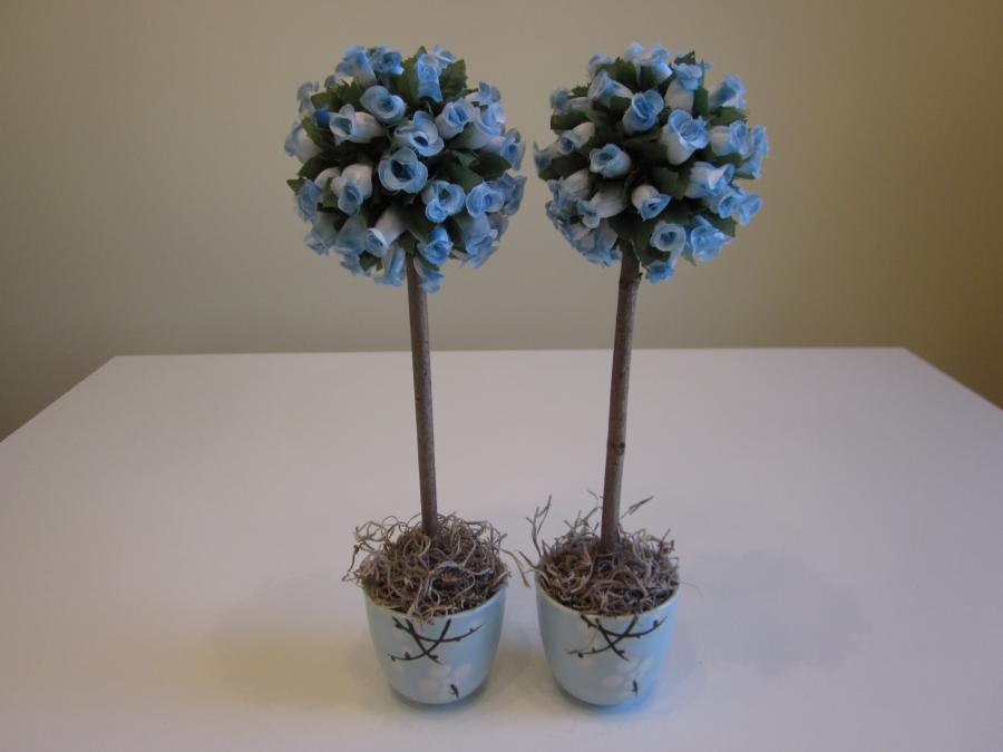 Pair of Light Blue Mini-Rosebud Topiaries. Mini faux light blue rosebud round ball topiary set in Japanese blue-and-white ceramic teacup with hand-painted florals; cup is 2-3/4` H; 12` H x 3` W overall dimensions.