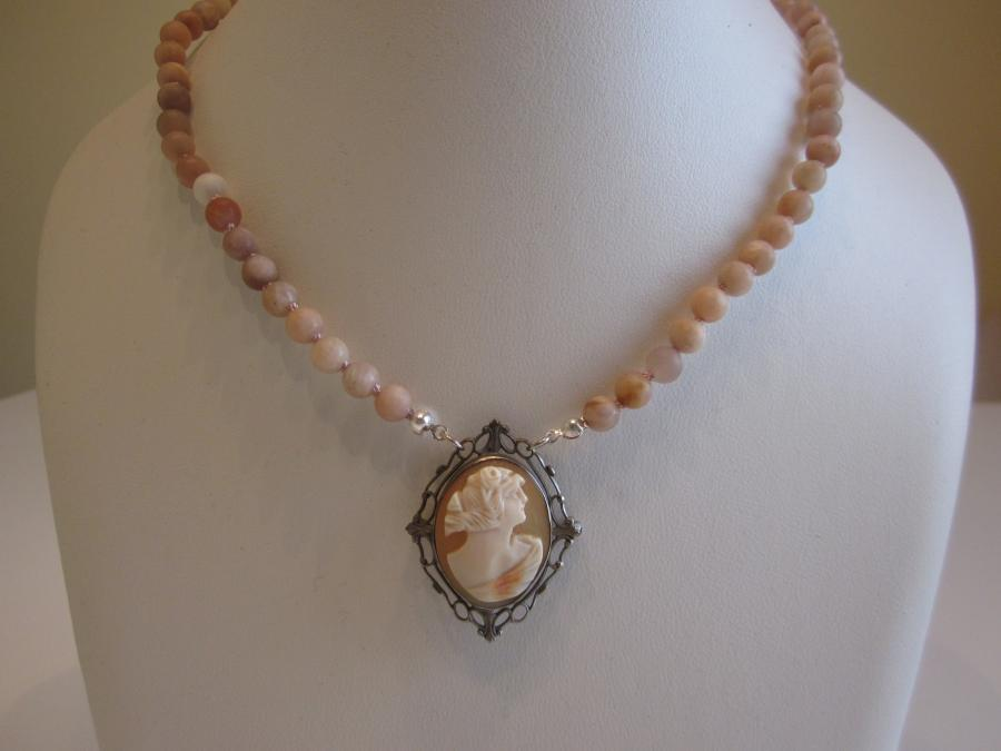 Antique Cameo & Sunstone Beaded Necklace. 6mm round matte-finished sunstone and antique shell cameo beaded necklace, hand-knotted on matching silk cord, 19-inches length, and finished with a sterling silver heart-shaped lobster clasp.