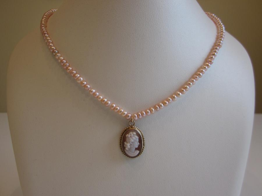 Vintage Shell Cameo Pink Cultured Freshwater Seed Pearl Necklace. Vintage shell cameo in gold-filled rope frame, pink cultured freshwater seed pearl necklace, hand-knotted on matching silk cord, finished with a gold-filled filigree clasp, 18-inches length.