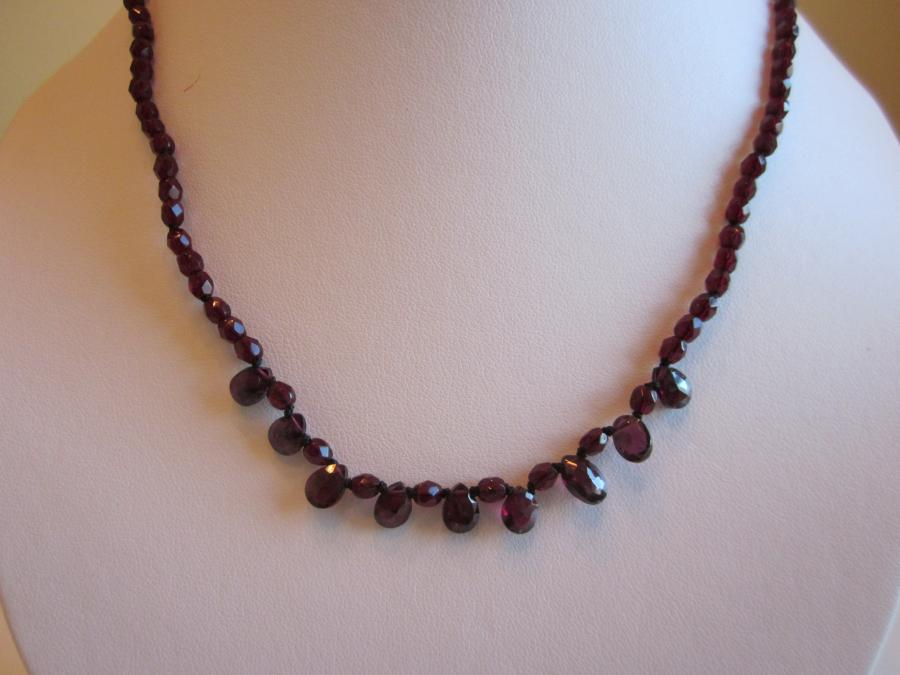 Red Garnet Necklace. Red garnet 9-briolette dangle necklace of diamond-cut red garnet round beads, gold-filled lobster clasp closure, 17-inches length.
