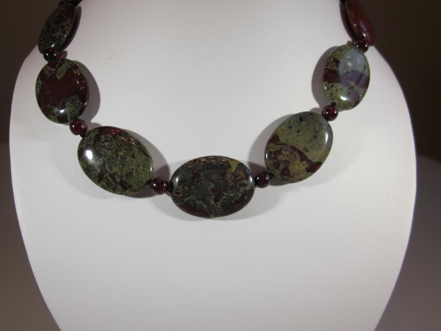 Oval Dragon Jasper & Red Garnet Bead Necklace. Oval dragon jasper & red garnet bead necklace, handknotted on black silk cord, 16 inches length, sterling silver lobster clasp