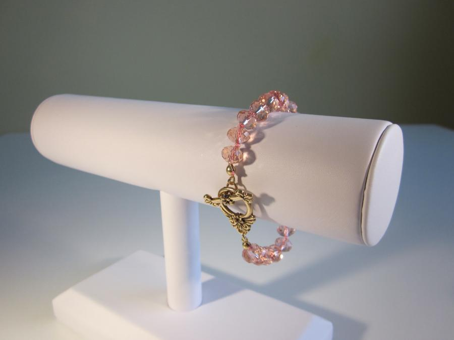 Pink Swarovski Crystal Bracelet. Pink Swarovski crystal bead bracelet, handknotted on matching pink silk cord with fancy brass toggle clasp, 7-1/4 inches length