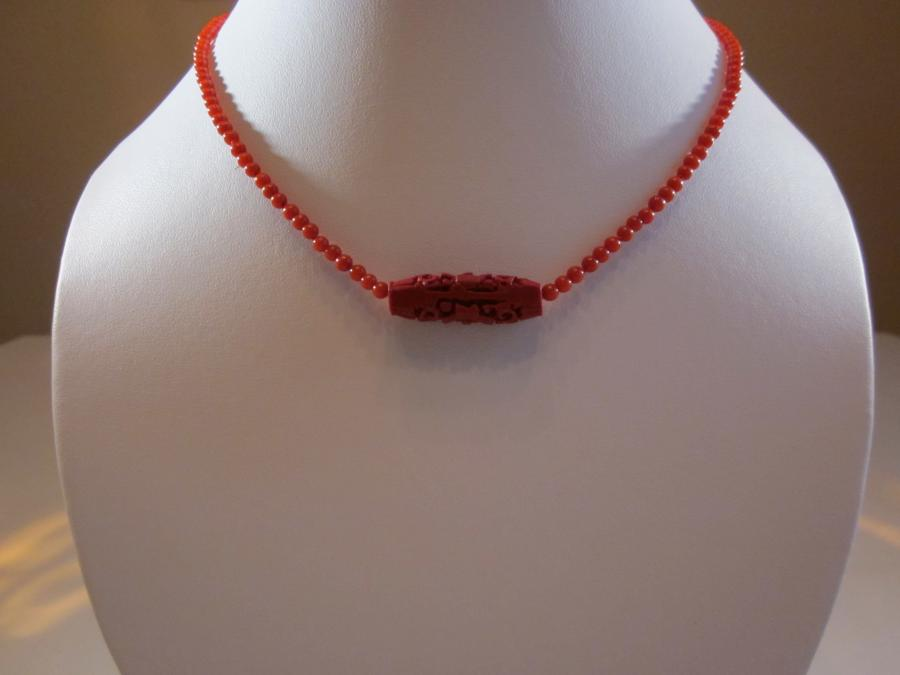 Red Coral & Cinnabar Necklace. 2mm red coral bead necklace with red cinnabar pendant, handknotted on red silk cord, 20 inches length, gold plated lobster clasp<br /><br />
