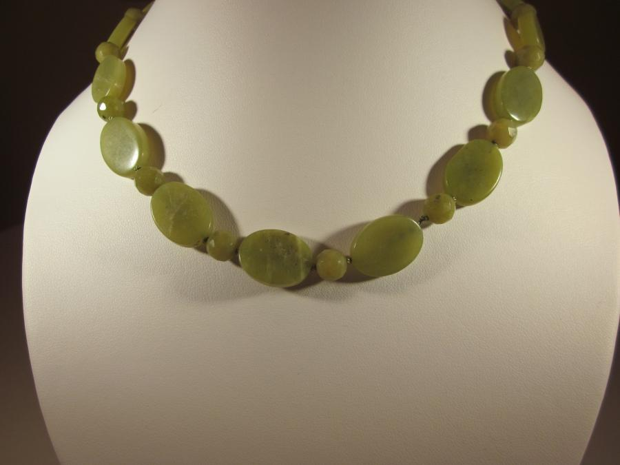 Jade Necklace. Serpentine olive jade bead necklace, handknotted on olive silk cord, 22 inches length, brass lobster clasp