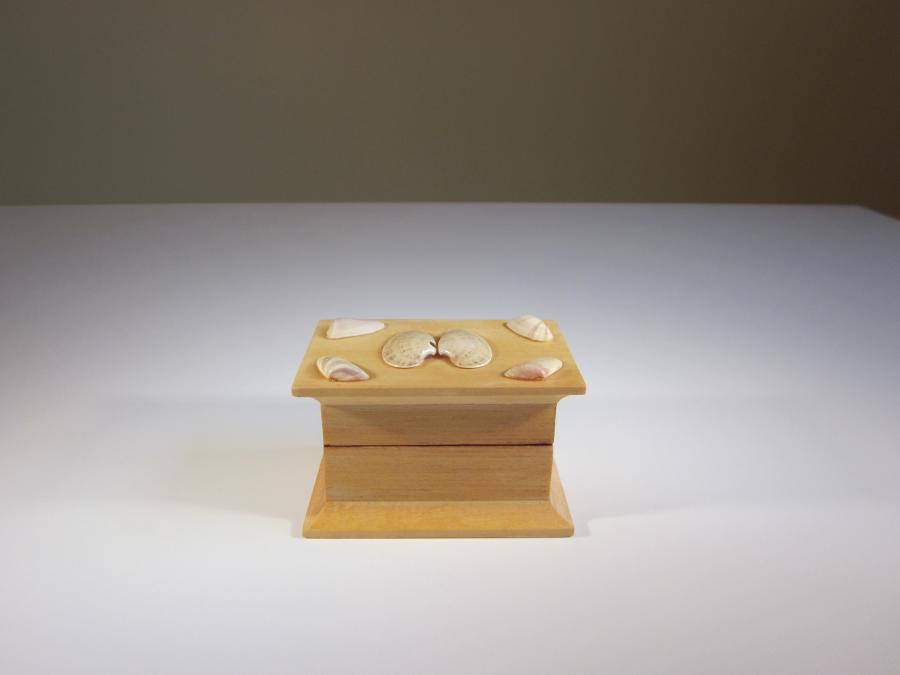 Basswood & Seashell Dream Box. Handcrafted basswood and natural shell dream box, rectangular shape 3-1/2`W x 2-3/8`D x 2`H, hinged top with beveled lid and base, exterior clear polyurethane finish, unfinished interior.<br /><br />Ideal for storing small jewelry.<br /><br />A Dream Box is meant to serve as <br />a physical reminder<br />that dreams will come true <br />if you search deep within your heart.<br /><br />Write your dream on a piece of paper. <br />Fold the paper and place it in <br />the Dream Box.<br /><br />May your days be filled with rainbows <br />and your nights with stars.<br />