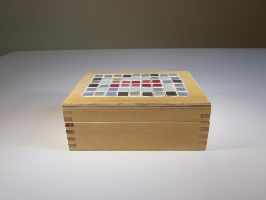 Inlaid Tile & Basswood Dream Box. Rectangular basswood and inlaid mosaic tile dream box, rectangular shape 5-3/4`W x 4-1/8`D x 2-1/8`H, hinged lid, clear polyurethane finish, unfinished natural wood interior.<br /><br />Ideal for larger jewelry pieces.<br /><br />A Dream Box is meant to serve as <br />a physical reminder<br />that dreams will come true <br />if you search deep within your heart.<br /><br />Write your dream on a piece of paper. <br />Fold the paper and place it in <br />the Dream Box.<br /><br />May your days be filled with rainbows <br />and your nights with stars.<br />