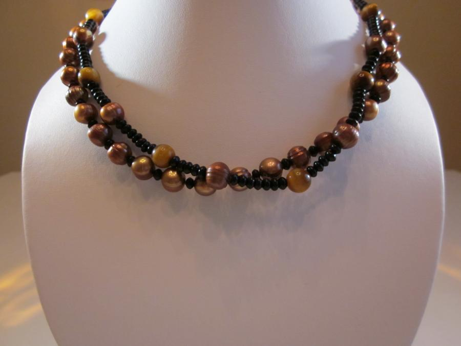 Two-Strand Chocolate Pearl-Black Onyx Necklace. Two-strand chocolate freshwater pearl and black onyx bead necklace, handknotted on brown silk cord, 17 inches length, gold filled Chinese clasp