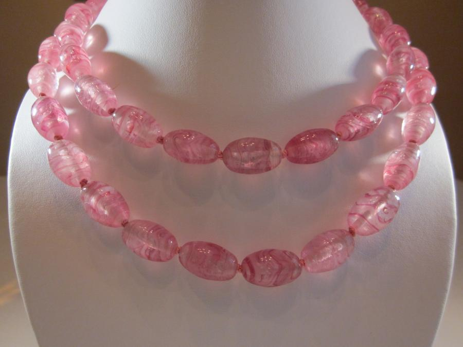 Two-Strand Vintage Pink Glass Bead Necklace. Two strand vintage pink glass bead necklace, 21 inches/24 inches, handknotted on pink silk cord, sterling silver clasp