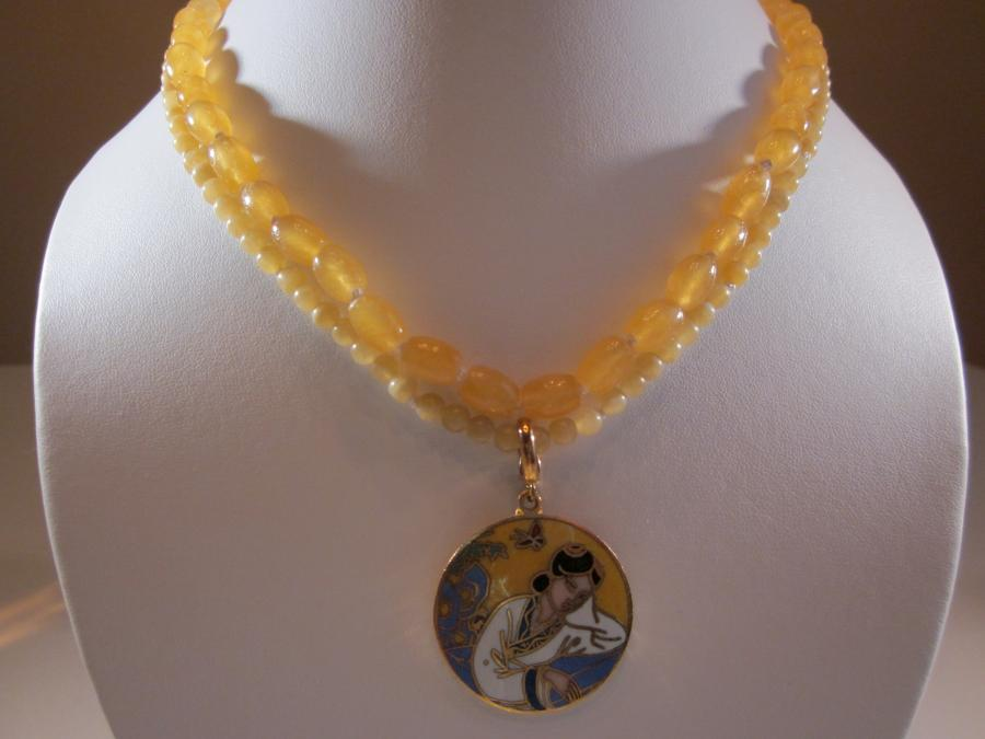 Two-Strand Yellow Jade with Enameled Medallion Bead Necklace. Two-strand yellow jade bead necklace with enameled medallion pendant, handknotted on white silk cord, 16-1/2 inches length, gold-filled large spring ring clasp