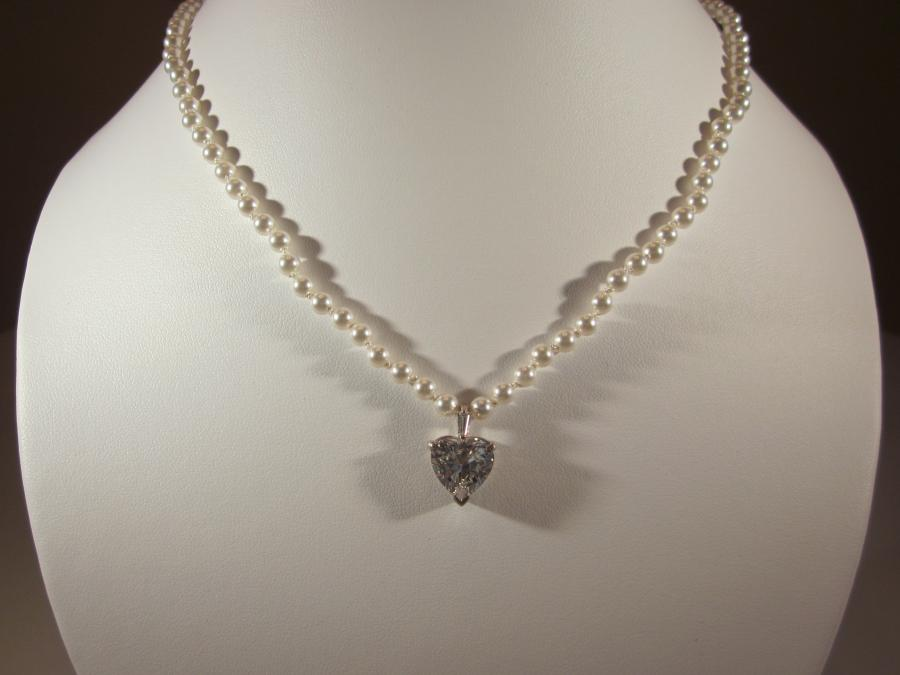 Glass Pearl & CZ Heart Pendant. White Swarovski glass pearl with sterling silver CZ heart pendant, handknotted on white silk cord, 18 inches length, sterling silver lobster clasp