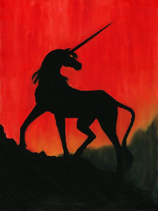 Sunset Unicorn. Dramatic silhouette of a unicorn on a mountain against a deep red sunset sky